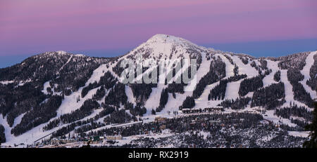 Night Skiing runs light up on Mount Washington ski resort as dusk settles on the popular Vancouver Island ski resort., The Comox Valley, Vancouver Isl - Stock Photo