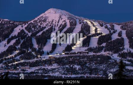 Night Skiing runs light up on Mount Washington ski resort as dusk settles on the popular Vancouver Island ski resort., The Comox Valley, Vancouver Isl - Stock Photo