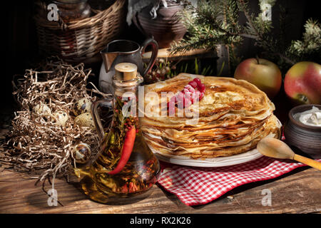 Plate with pancakes on an old wooden background - Stock Photo