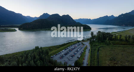Aerial view of a beautiful Canadian Landscape during a vibrant summer sunset. Taken in Pitt Lake, Greater Vancouver, BC, Canada. - Stock Photo