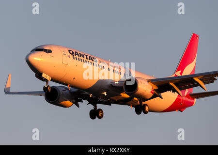 Qantas Boeing 737 aircraft on approach to land at Adelaide Airport. - Stock Photo