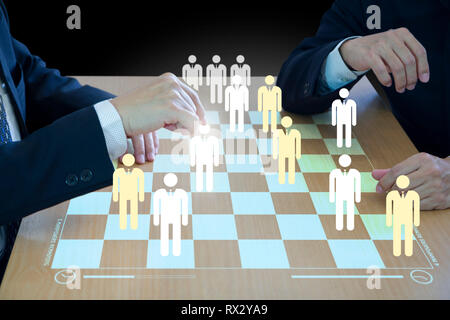 Three business administrators playing checkers or draughts on a wooden virtual checkerboard or draughtboard in concept of manpower or human resource. - Stock Photo