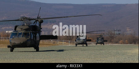 UH-60 Blackhawk helicopters 3rd Assault Helicopter Battalion, 1st Aviation Regiment, 1st Combat Aviation Brigade, 1st Infantry Division, land in formation on air field at Novo Selo Training Area, Bulgaria, March 4, 2019. 3-1 AHB recently began a rotation in Romania to support Atlantic Resolve, a joint NATO commitment to build readiness and enhance the bond between allied and partner nations through multinational training. (U.S. Army photo by Sgt. Gavin Lewis) - Stock Photo