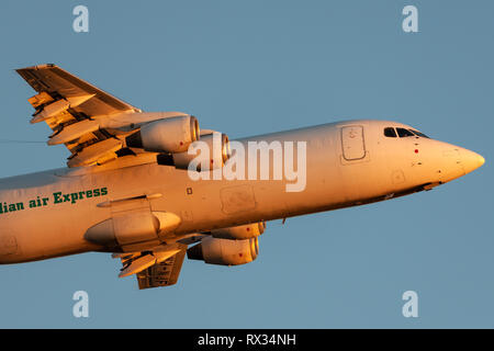 Australian Air Express (National Jet Systems) British Aerospace 146-300 aircraft VH-NJF taking off from Adelaide airport. - Stock Photo