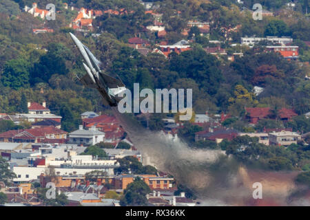 Royal Australian Air Force (RAAF) McDonnell Douglas F/A-18A Hornet fighter aircraft A21-55 performing a flying display. - Stock Photo