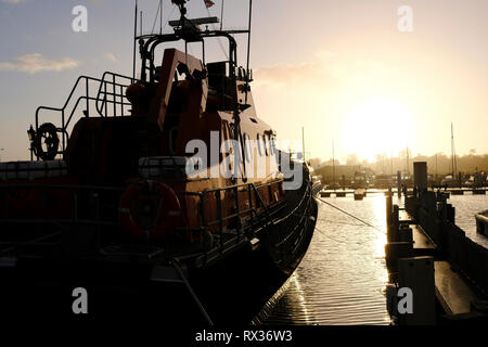 The Severn class Yarmouth RNLI Lifeboat moored in Yarmouth Marina on the Isle of Wight, UK. - Stock Photo