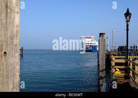 A Wightlink Ferry boat leaving its Yarmouth terminal at Yarmouth Harbour and Marina on the Isle of Wight crossing the Solent to Lymington Pier Head. - Stock Photo