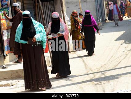 Veiled Bangladeshi women in a suburb of Dhaka. - Stock Photo