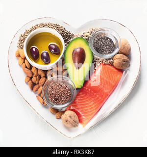 Selection of healthy fat sources. Healthy dieteating concept.Top view - Stock Photo