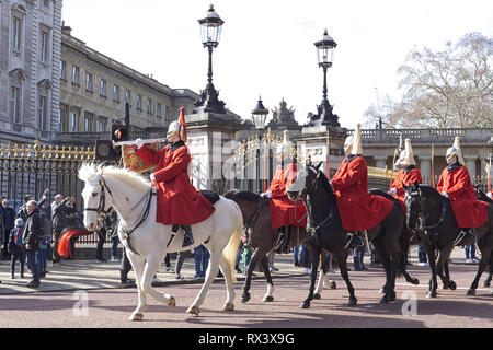 When The Queen is in London, the Long Guard consists one Officer, one Corporal Major, two Non-Commissioned Officers, one Trumpeter, and ten Troopers. - Stock Photo