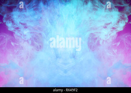 Abstract art colored  blue smoke on pink isolated background. Stop the movement of multicolored smoke on dark background - Stock Photo