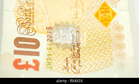 Side view of the 10 Pounds bill on the table. Showing the every details of the bill. - Stock Photo
