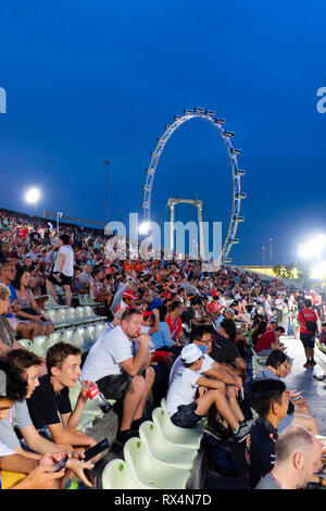 Crowd gathering for Singapore formula one Grand Prix with Singapore Flyer in background, Singapore 2018 - Stock Photo