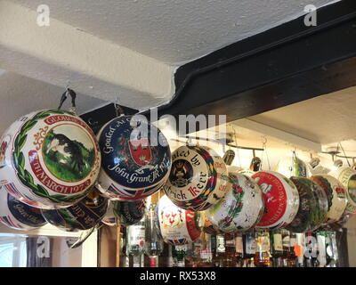 Painted balls from previous years' play in Ashbourne Shrovetide Football game hang in the bar at The Wheel Inn, Compton, Ashbourne, prior to 2019 game - Stock Photo