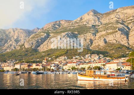 Makarska, Dalmatia, Croatia, Europe - An old traditional fishing boat at the harbor of Makarska - Stock Photo