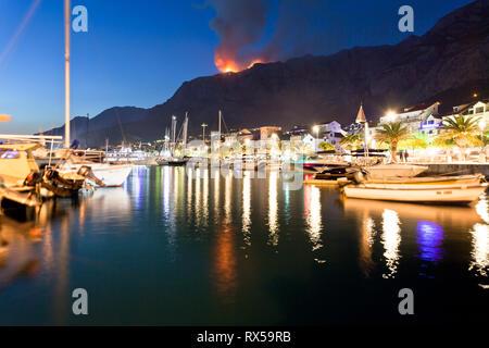 Makarska, Dalmatia, Croatia, Europe - A wildfire in the mountains of Makarska at night - Stock Photo