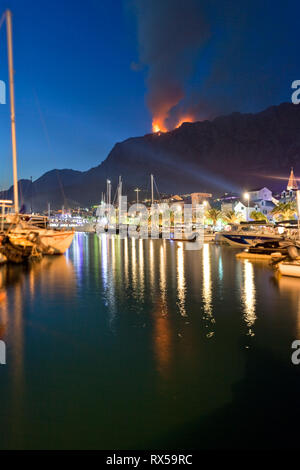 Makarska, Dalmatia, Croatia, Europe - A forest fire near the harbor of Makarska - Stock Photo