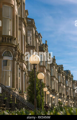 Grand Tenement Apartments on a Residential Street in Glasgow - Stock Photo