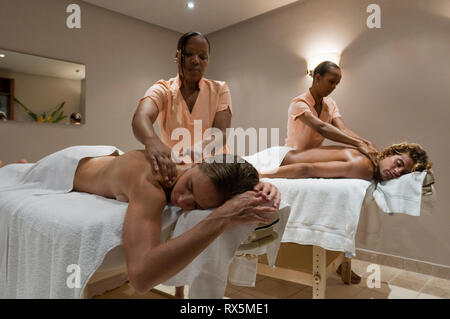 Couple receiving massages at resort - Stock Photo