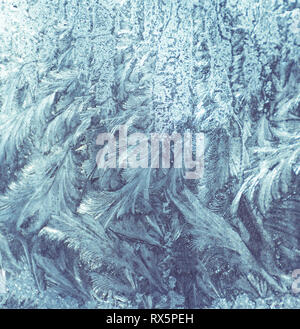 Frostwork. Decorative ice crystals on a window - Stock Photo