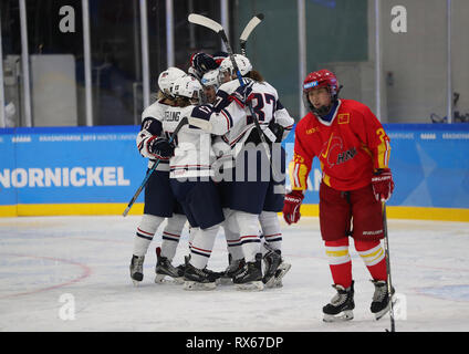 Krasnoyarsk, Russia. 8th Mar, 2019. Players of the United States celebrate scoring during the women's ice hockey preliminary round Group A match between China and the United States at the 29th Winter Universiade in Krasnoyarsk, Russia, March 8, 2019. The United States won 6-1. Credit: Wang Dongzhen/Xinhua/Alamy Live News - Stock Photo