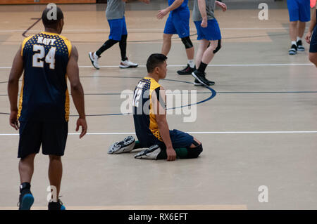 Fort Bragg, North Carolina, USA. 8th Mar, 2019. March 8, 2019 - Fort Bragg, N.C., USA - All-Navy Men's Volleyball Petty Officer 2nd Class Alejo Guilalas (12) kneels on the floor after missing a point during the final match between the U.S. Air Force and U.S. Navy at the 2019 Armed Forces Men's Volleyball Championship at Ritz-Epps Gym on Fort Bragg. Air Force defeated Navy, 3-2, winning gold in the three-day round-robin tournament. The Armed Forces Men's and Women's Volleyball Championships are held annually. Credit: Timothy L. Hale/ZUMA Wire/Alamy Live News - Stock Photo