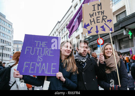Brussels, Belgium. 8th Mar, 2019. People hold placards as they attend a women's strike in Brussels, Belgium, March 8, 2019. Thousands of women went on strike across Belgium on International Women's Day to campaign for women's rights and gender equality, local media reported. Credit: Zhang Cheng/Xinhua/Alamy Live News - Stock Photo