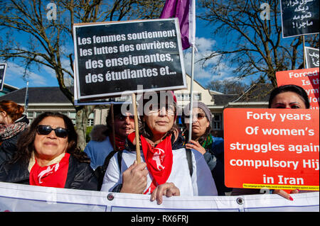 Brussels, North Brabant, Belgium. 8th Mar, 2019. Protesters are seen holding placards during the demonstration.On the 40th anniversary of the 5-days women's uprising against 'compulsory hijab order'' in 1979 in Iran. Women around several cities in Europe took the streets for 3 days on 6th, 7th, and 8th of March 2019, to resound the struggle of 'revolutionary women in 1979'' against compulsory hijab in Iran. In Brussels, a demonstration took place in front of the embassy of the Islamic Republic of Iran, after that they demonstrated also in front of the US embassy. (Credit Image: © An - Stock Photo
