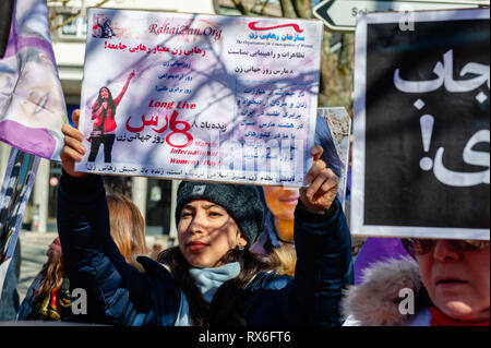 Brussels, North Brabant, Belgium. 8th Mar, 2019. A woman is seen holding a placard during the protest.On the 40th anniversary of the 5-days women's uprising against 'compulsory hijab order'' in 1979 in Iran. Women around several cities in Europe took the streets for 3 days on 6th, 7th, and 8th of March 2019, to resound the struggle of 'revolutionary women in 1979'' against compulsory hijab in Iran. In Brussels, a demonstration took place in front of the embassy of the Islamic Republic of Iran, after that they demonstrated also in front of the US embassy. (Credit Image: © Ana Fernand - Stock Photo