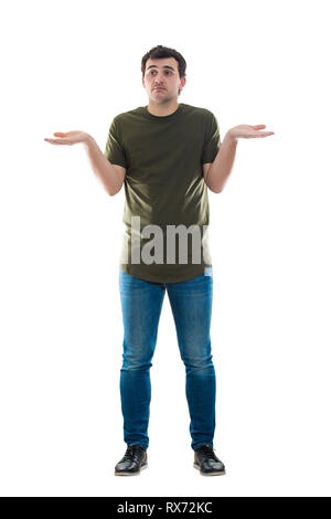 Full length portrait confused young man showing hands raised isolated over white background. Oops. Sorry. Don't know what to do. Casual male shrugs, s - Stock Photo