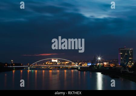Night view on Bratislava the capital of Slovakia on Danube River. Lighted Castle, bridges and panorama. Wide shot - Stock Photo