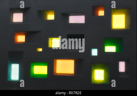 Modern design wall with abstract windows of different shapes and colored lights - Stock Photo