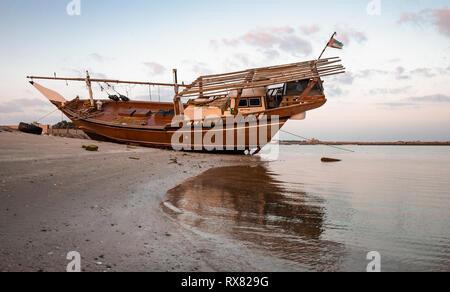 old dhow on a beach in Ras al Khaimah, United Arab Emirates - Stock Photo