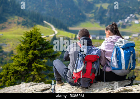 Smiling adventure couple with map on slope. look at map - Stock Photo