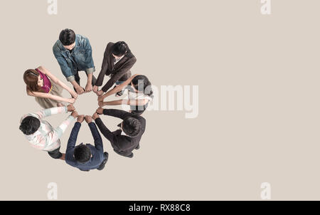 Top view of teen people in team fist bump assemble together. - Stock Photo