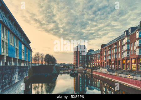 DUESSELDORF, GERMANY - MARCH 12, 2017: The Altstadt harbor attracts visitors from all over the world and shines during the blue hour. - Stock Photo