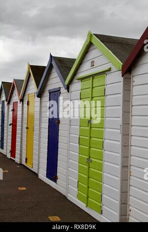 Brightly Coloured  Wooden Beach Huts on the Promenade at Paignton  in the Torbay area of Devon.England UK - Stock Photo