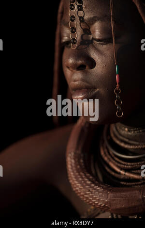 A portrait of a Himba woman in Namibia. - Stock Photo