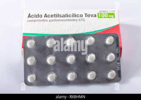 A box of acetylsalicylic acid tablets isolated on white. Infantile aspirin. Photo taken in Madrid, Spain, on March 8, 2019. - Stock Photo