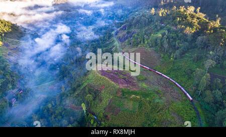 Aerial. Train from Ella to Kandy in mountains. Sri Lanka. - Stock Photo