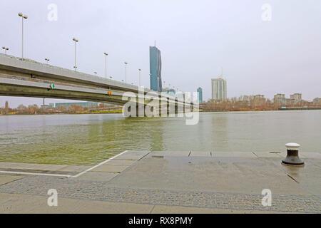 VIENNA, AUSTRIA - JANUARY 9, 2019: Danube City or Donaustadt is district of Vienna, Austria. Reichsbrücke bridge with Danube City, a modern quarter wi - Stock Photo