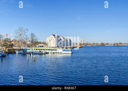 Berlin, Germany - February 22, 2019: Maselake bay of the River Havel with three buildings of the former storehouse of the army rations department unde - Stock Photo