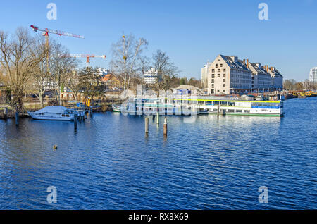 Berlin, Germany - February 22, 2019: Maselake bay of the River Havel with three buildings of the former storehouse of the army rations department - Stock Photo