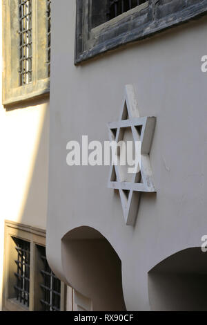 Star of David on the facade of a synagogue in Prague - Stock Photo