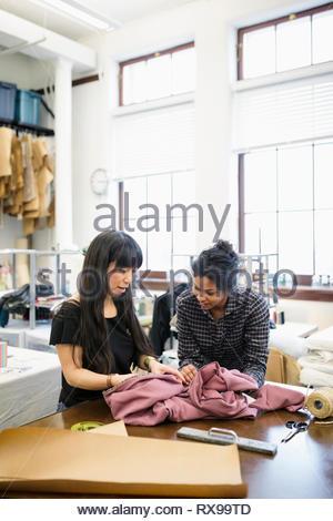 Female fashion designers working in studio - Stock Photo