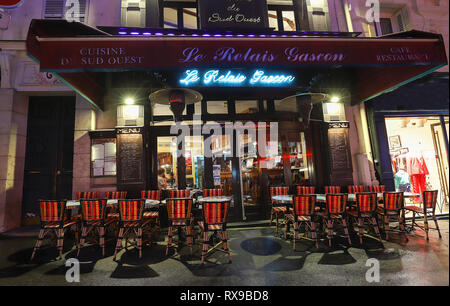 The Cafe Le relais gascon is a cafe in the Montmartre at rainy night , Paris, France.