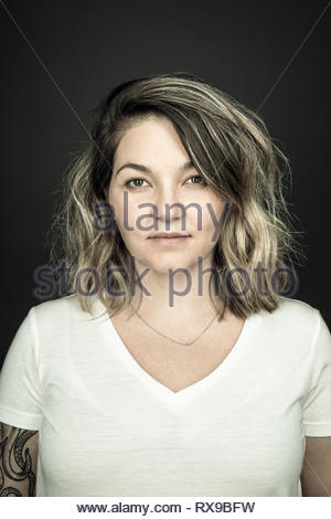 Portrait confident beautiful blonde woman - Stock Photo