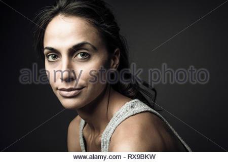 Portrait confident beautiful young brunette woman - Stock Photo