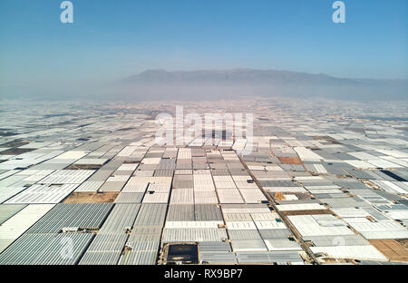 Aerial above drone point of view many polythene plastic exterior greenhouses hothouses where cultivated fruits and vegetables in the Almerimar, provin - Stock Photo