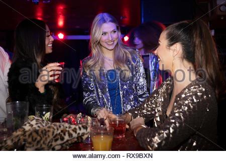 Women friends drinking in nightclub - Stock Photo